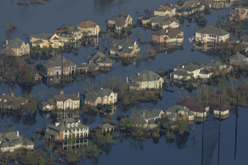 Two weeks after Hurricane Katrina hit New Orleans, neighborhoods were still flooded with oil and water. People who are exposed to disaster zones for longer and receive less support afterward are more vulnerable to mental health issues. (Carlos Barria / Reuters)
