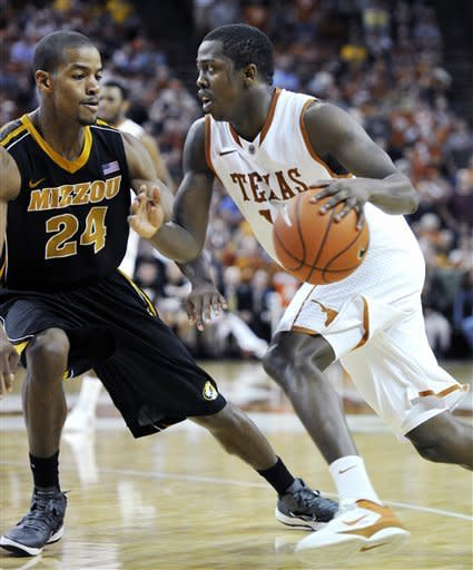 Texas guard J'Covan Brown, right, drives to the basket against Missouri guard Kim English, left, during the second half of an NCAA college basketball game, Monday, Jan. 30, 2012, in Austin, Texas. Missouri won 67-66. (AP Photo/Michael Thomas)