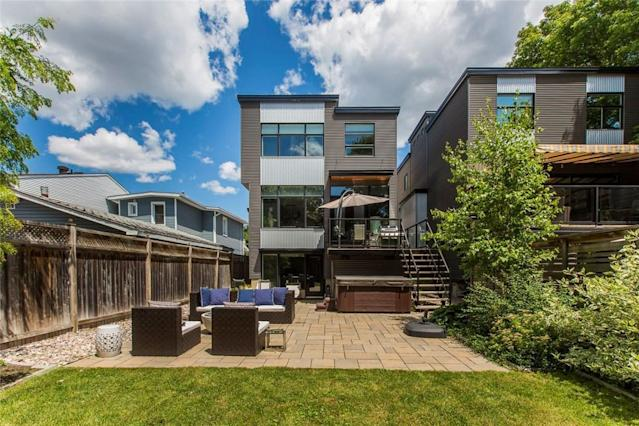 <p><span>546 Hilson Avenue, Ottawa, Ont.</span><br> Outside, the backyard is surrounded by mature trees, giving you privacy to lounge on the deck or hang out in the hot tub.<br> (Photo: Zoocasa) </p>