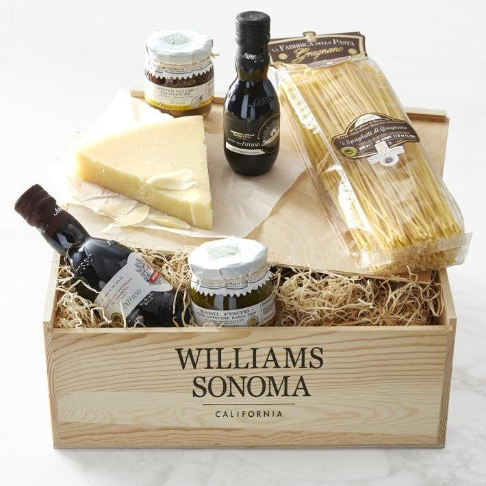 """<h2>Italian Pantry Gift Crate</h2><br>Take a trip to Italy and embrace common food practices with this authentic pantry gift crate; filled to the brim with Italian household staples. <br><br><strong><em><a href=""""https://www.williams-sonoma.com/shop/food/"""" rel=""""nofollow noopener"""" target=""""_blank"""" data-ylk=""""slk:Shop Williams-Sonoma"""" class=""""link rapid-noclick-resp"""">Shop Williams-Sonoma</a></em></strong><br><br><strong>Williams-Sonoma</strong> Williams Sonoma Italian Pantry Gift Crate, $, available at <a href=""""https://go.skimresources.com/?id=30283X879131&url=https%3A%2F%2Fwww.williams-sonoma.com%2Fproducts%2Fwilliams-sonoma-italian-pantry-gift-crate%2F"""" rel=""""nofollow noopener"""" target=""""_blank"""" data-ylk=""""slk:Williams-Sonoma"""" class=""""link rapid-noclick-resp"""">Williams-Sonoma</a>"""