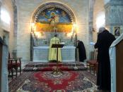 Iraqi monks pray during a mass at the Virgin Mary Church in Alqosh