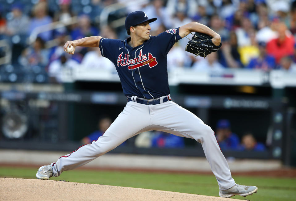 Atlanta Braves starting pitcher Kyle Wright (30) throws against the New York Mets during the first inning of a baseball game Wednesday, June 23, 2021, in New York. (AP Photo/Noah K. Murray)