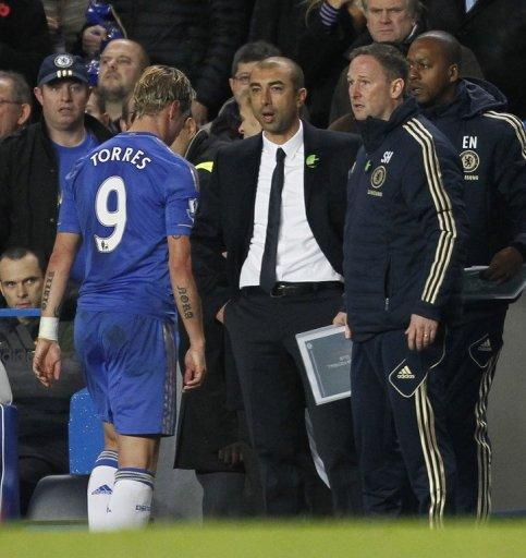 Chelsea's Spanish striker Fernando Torres (L) trudges past Chelsea's Italian manager Roberto Di Matteo after was sent off during the English Premier League football match between Chelsea and Manchester United at Stamford Bridge on October 28. Manchester United won the game 3-2