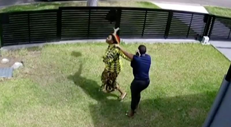 The angry wife rips off the wig and throws it into the distance. Photo: 7 News