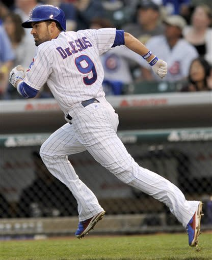 Chicago Cubs' David DeJesus watches his solo home run during the first inning of a baseball game against the Colorado Rockies in Chicago, Wednesday, May 15, 2013. (AP Photo/Paul Beaty)