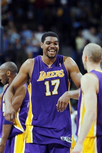 Los Angeles Lakers center Andrew Bynum, back, jokes with guard Steve Blake as time runs out in the fourth quarter of the Lakers' 92-88 victory over the Denver Nuggets in Game 4 of the teams' first-round NBA basketball series in Denver on Sunday, May 6, 2012. (AP Photo/David Zalubowski)