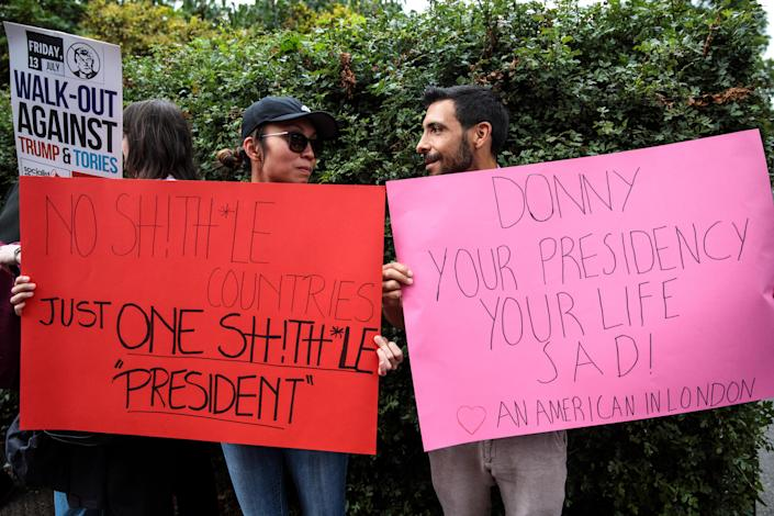<p>Protesters gather with signs outside Winfield House, the London residence of US ambassador Woody Johnson, where US President Donald Trump and First Lady Melania Trump are staying tonight on July 12, 2018 in London, Britain. (Photo: Jack Taylor/Getty Images) </p>