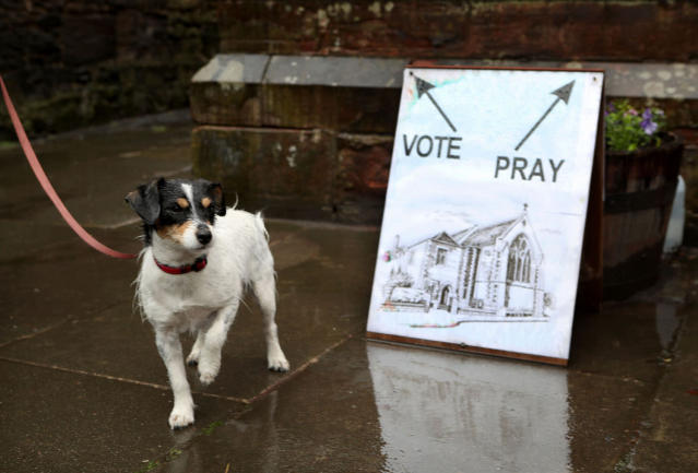 <p>Skye the dog waits outside a polling station in St James' Church, Edinburgh as voters head to the polls across the UK to vote in the General Election. (Photo: Jane Barlow/Getty Images) </p>