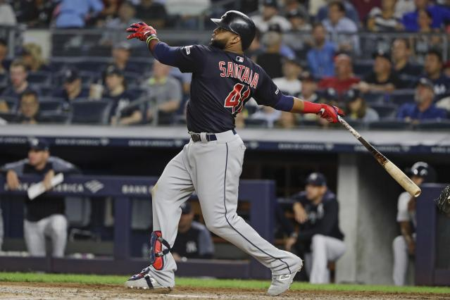 Cleveland Indians' Carlos Santana follows through on a two-run home run during the fourth inning of the team's baseball game against the New York Yankees on Thursday, Aug. 15, 2019, in New York. (AP Photo/Frank Franklin II)