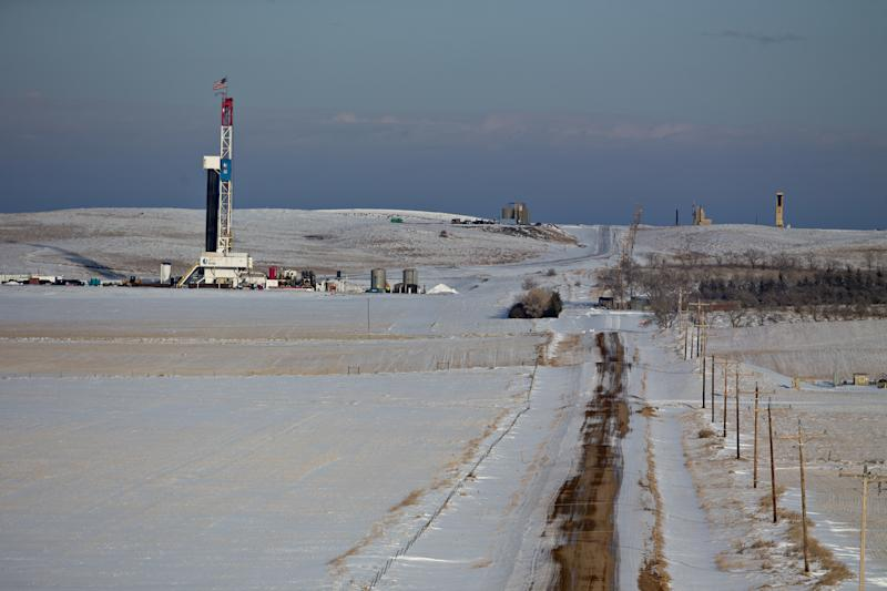 An American flag flies on top of a Unit Drilling Co. rig in the Bakken Formation outside Watford City, North Dakota. (Bloomberg via Getty Images)