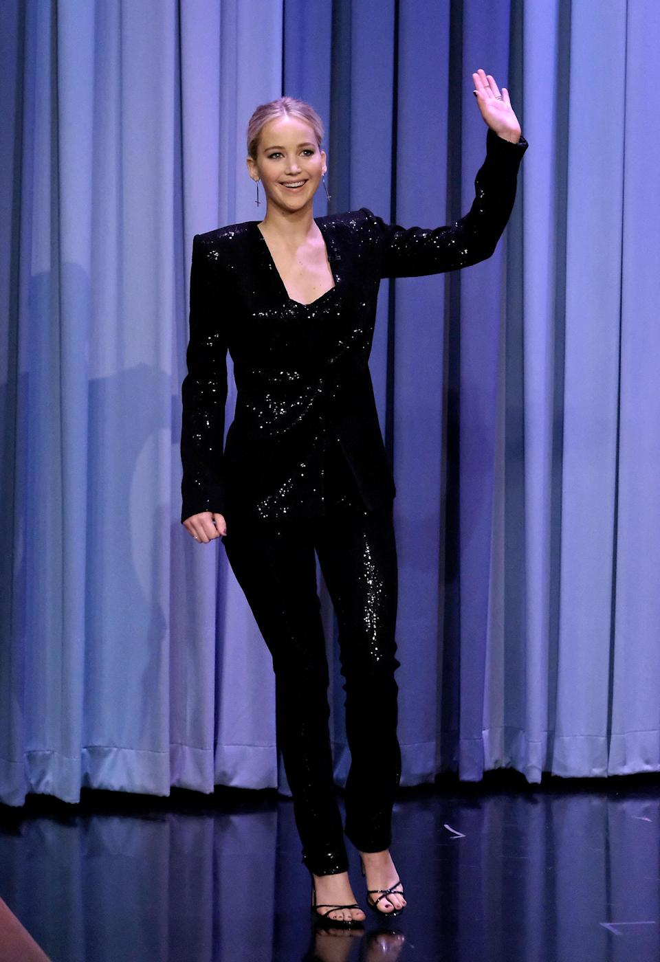 <p>Jennifer made an unforgettable appearance on 'The Tonight Show with Jimmy Fallon' wearing a sequinned black suit by Sally LaPointe paired with strappy black heels.<br><i>[Photo: Getty]</i> </p>