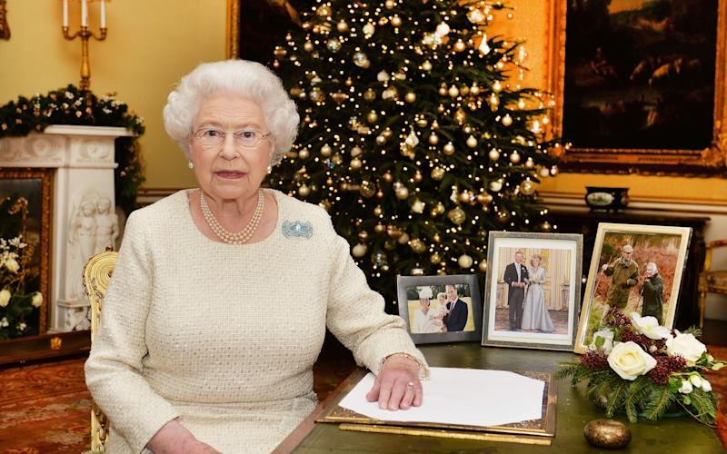 Queen Elizabeth II sits at a desk in the 18th Century Room at Buckingham Palace, London, after recording her Christmas Day broadcast to the Commonwealth in 2015