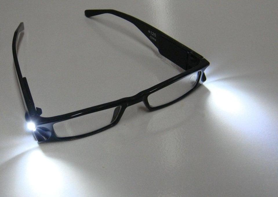 <p>How game-changing are these <span>Lightspecs Reading Glasses</span> ($10)? Customers absolutely rave about them, and the top reviews recommend buying batteries in bulk for when the LED lights run out.</p>
