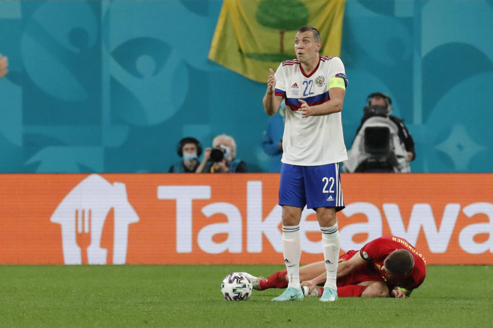 Russia's Artem Dzyuba reacts during the Euro 2020 soccer championship group B match between Belgium and Russia at the Saint Petersburg stadium in St. Petersburg, Russia, Saturday, June 12, 2021. (Anatoly Maltsev/Pool via AP)
