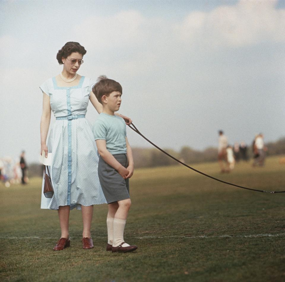 Queen Elizabeth II with Prince Charlesduring a polo match at Windsor Great Park in 1956.