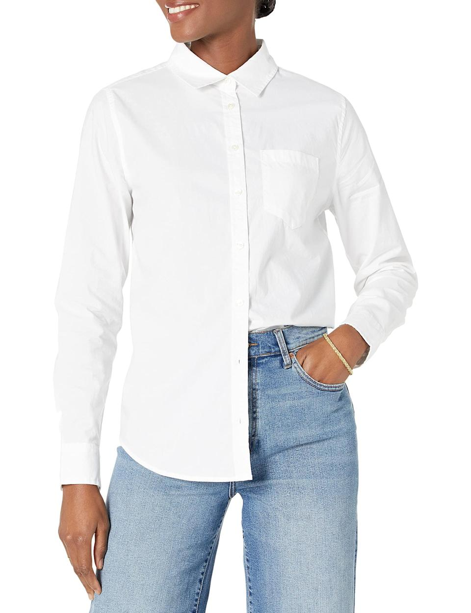 """<h2>Amazon Essentials Classic-Fit Button-Down Poplin Shirt</h2><br><strong>Best Amazon White Button-Down</strong><br>Over 6,000 Amazon reviewers rave about this very affordable button-down's classic tailoring, comfortable fit, and wrinkle resistance.<br><br><strong>The Hype:</strong> 4.3 out of 5 stars and 6,219 reviews on Amazon<br><br><strong>What They're Saying: </strong>""""I have both the Amazon Essentials classic fit button-down Oxford and the Amazon Essentials classic fit button-down poplin shirts. I absolutely love both. This shirt, the poplin, is lighter weight and wrinkles much less straight from the dryer. Both shirts have a men's style fit, with no darts to nip in the waist. The length is just below the bottom. The cuff is crisp and has a double button to make turning the cuff once or twice secure and tidy. This style is best for layering, as it is light and cool. The black gingham is pure, classic preppy. I rarely buy items before they go on sale, but I wanted this pattern and would pay full price again. Perfect.""""<br><br><strong>Amazon Essentials</strong> Classic-Fit Long Sleeve Button Down Poplin Shirt, $, available at <a href=""""https://amzn.to/2W5i034"""" rel=""""nofollow noopener"""" target=""""_blank"""" data-ylk=""""slk:Amazon"""" class=""""link rapid-noclick-resp"""">Amazon</a>"""