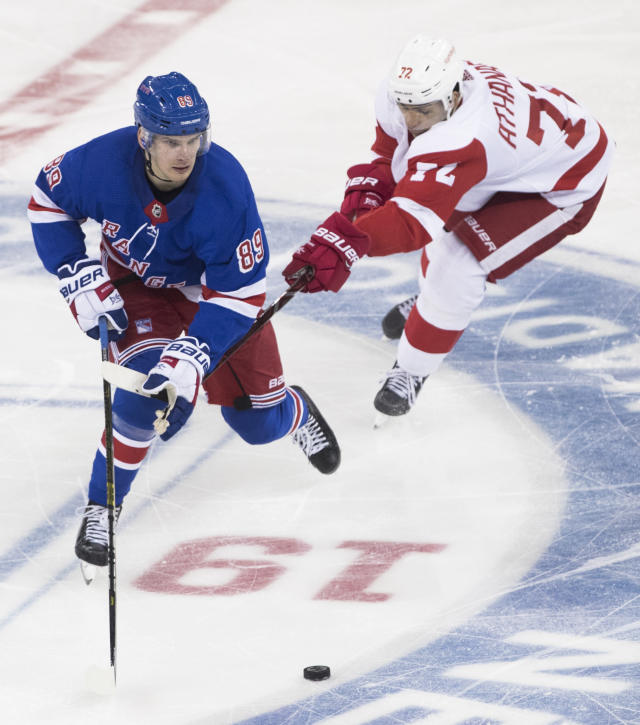 New York Rangers right wing Pavel Buchnevich (89) skates against Detroit Red Wings center Andreas Athanasiou (72) during the third period of an NHL hockey game, Tuesday, March 19, 2019, at Madison Square Garden in New York. The Red Wings won 3-2. (AP Photo/Mary Altaffer)
