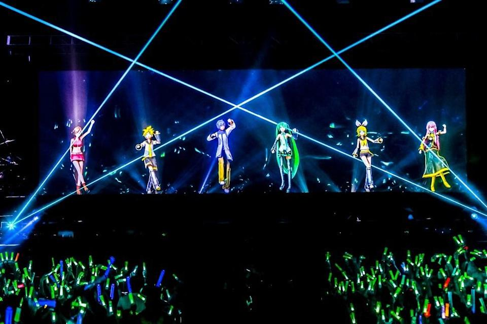 Virtual idols performing in a Bilibili concert in front of a live physical audience of 8,000 people in 2019. Photo: Handout