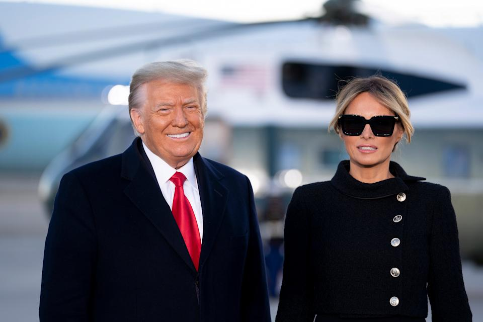 President Donald Trump, left, and First Lady Melania Trump arrive to a farewell ceremony at Joint Base Andrews (EPA)