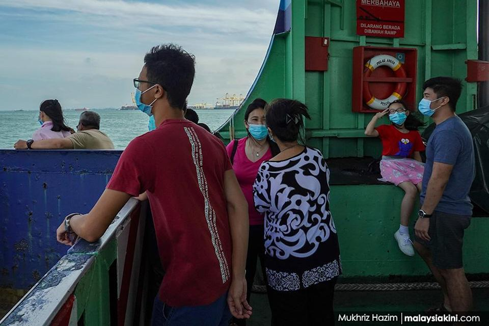 Passengers wearing protective masks on a ferry in Georgetown, Penang on Jan 4, 2021.