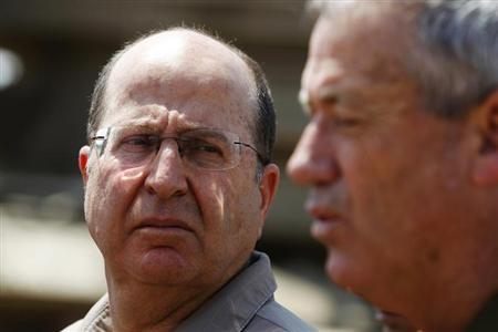 Israeli Defense Minister Yaalon looks at Israel's armed forces chief Major-General Gantz during a visit to a military base outside central Gaza Strip