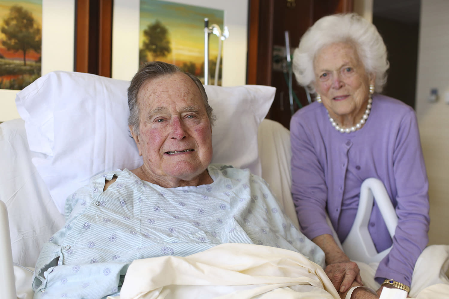 Former President George H.W. Bush and his wife Barbara pose for a photo at Houston Methodist Hospital in Houston. The 92-year-old former president is still suffering from pneumonia, but is well enough to leave the intensive care unit at a Houston hospital, doctors said Monday. His wife, Barbara, has been discharged from the same facility after completing treatment for bronchitis. (Courtesy the Office of George H.W. Bush via AP)