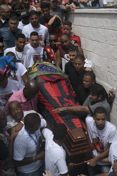 Friends and relatives carry the coffin that contain the remains of Samuel de Souza Rosa, one of the 10 young soccer players killed in a fire at the training ground of Brazilian soccer club Flamengo, during his funeral in Sao Joao de Meriti, Brazil, Monday, Feb. 11, 2019. The death of de Souza Rosa and his teammates has shed a tragic light on the state of shoddy infrastructure and lax oversight in Latin America's largest nation. (AP Photo/Leo Correa)