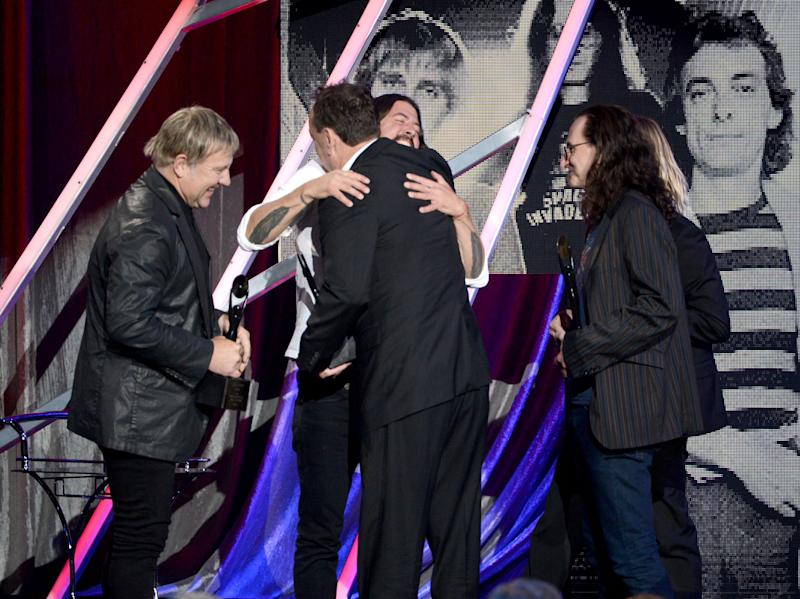 Dave Grohl Hugs Neil Peart at the Rock And Roll Hall Of Fame