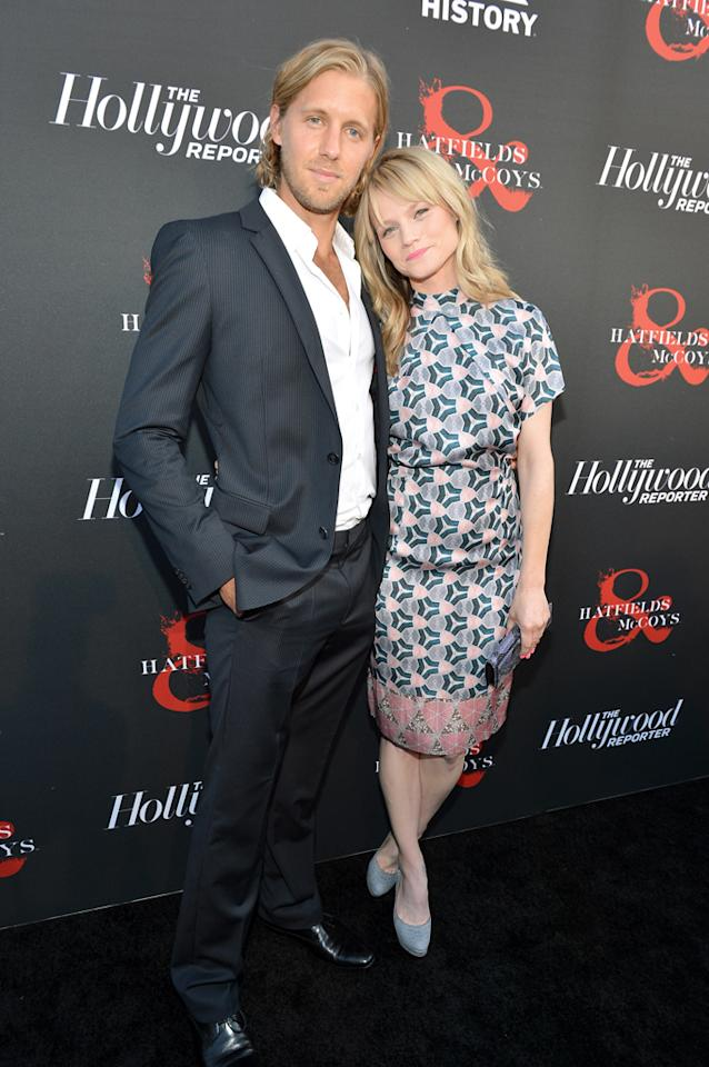 "Matt Barr and Lindsay Pulsipher attend a special screening of ""Hatfields & McCoys"" hosted by The History Channel at Milk Studios on May 21, 2012 in Hollywood, California."