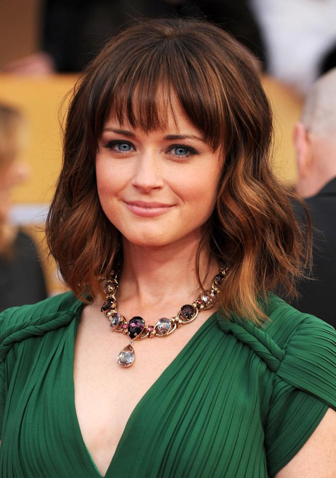 "FILE - In this Jan. 27, 2013 file photo, Alexis Bledel arrives at the 19th Annual Screen Actors Guild Awards in Los Angeles. Netflix says ""Gilmore Girls: A Year in the Life"" will debut globally on Nov. 25, 2015, with the show's original stars, Lauren Graham, who plays Lorelai Gilmore and Bledel, who plays her daughter Rory. (Photo by Jordan Strauss/Invision/AP, File)"