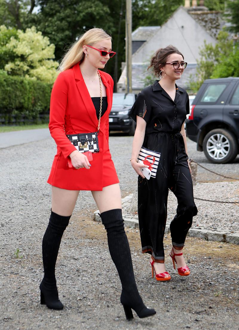 Actresses Sophie Turner (left) and Maisie Williams arrive at Rayne Church, Kirkton of Rayne in Aberdeenshire, for the wedding ceremony of their Game Of Thrones co-stars Kit Harington and Rose Leslie. (Photo by Jane Barlow/PA Images via Getty Images)