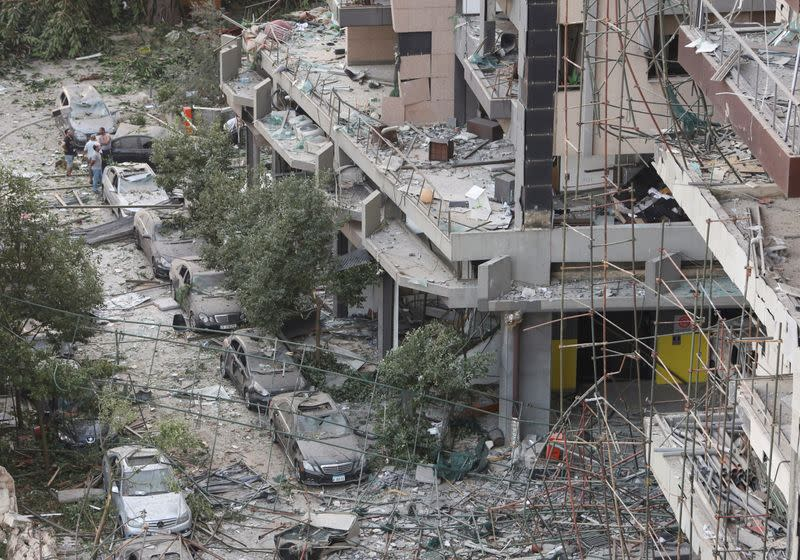 People inspect the damage near the site of Tuesday's blast in Beirut's port area