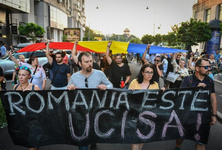 'Romania has been killed': Protesters accuse the government of weakening the criminal justice system with controversial reforms (AFP Photo/Daniel MIHAILESCU)