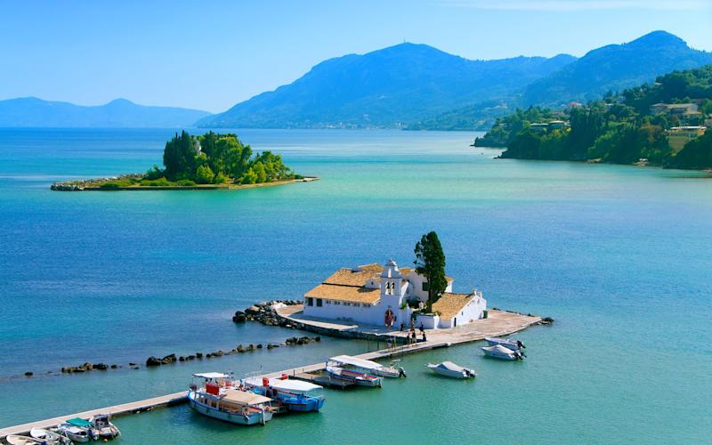 Corfu has an enticing mix of historical monuments, lush hillsides, blue skies, sand and pebble beaches and calm azure waters - AleksandarGeorgiev