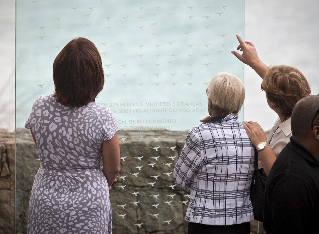 Relatives of victims of the 2009 Air France flight 447 accident look at a plaque in memory of the passengers in Rio de Janeiro, Brazil, Wednesday, June 1, 2011. In the past week, French authorities have pulled from the Atlantic Ocean 127 bodies from the Rio de Janeiro to Paris flight that crashed on June 1, 2009. All 228 people aboard the plane died.