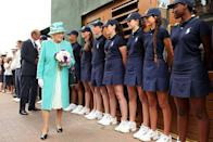<p>The Queen wore a turquoise coat and hat. </p>