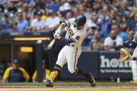 Milwaukee Brewers' Milwaukee Brewers second baseman Kolten Wong hits a double against the Pittsburgh Pirates during the third inning of a baseball game Wednesday, Aug. 4, 2021, in Milwaukee. (AP Photo/Jeffrey Phelps)