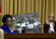 FILE - In this Feb. 26, 2019, file photo, Rep. Sheila Jackson Lee, D-Texas, displays a photo as she speaks during the House Judiciary Committee on the Trump administration's separation policy involving migrant families on Capitol Hill in Washington. Attorney General Merrick Garland has tossed out a Trump administration policy that barred immigration judges from temporarily shelving some deportation cases. Garland on Thursday, July 15, overruled a decision by then-Attorney General Jeff Sessions that judges couldn't put those cases on hold. (AP Photo/Jose Luis Magana, File)