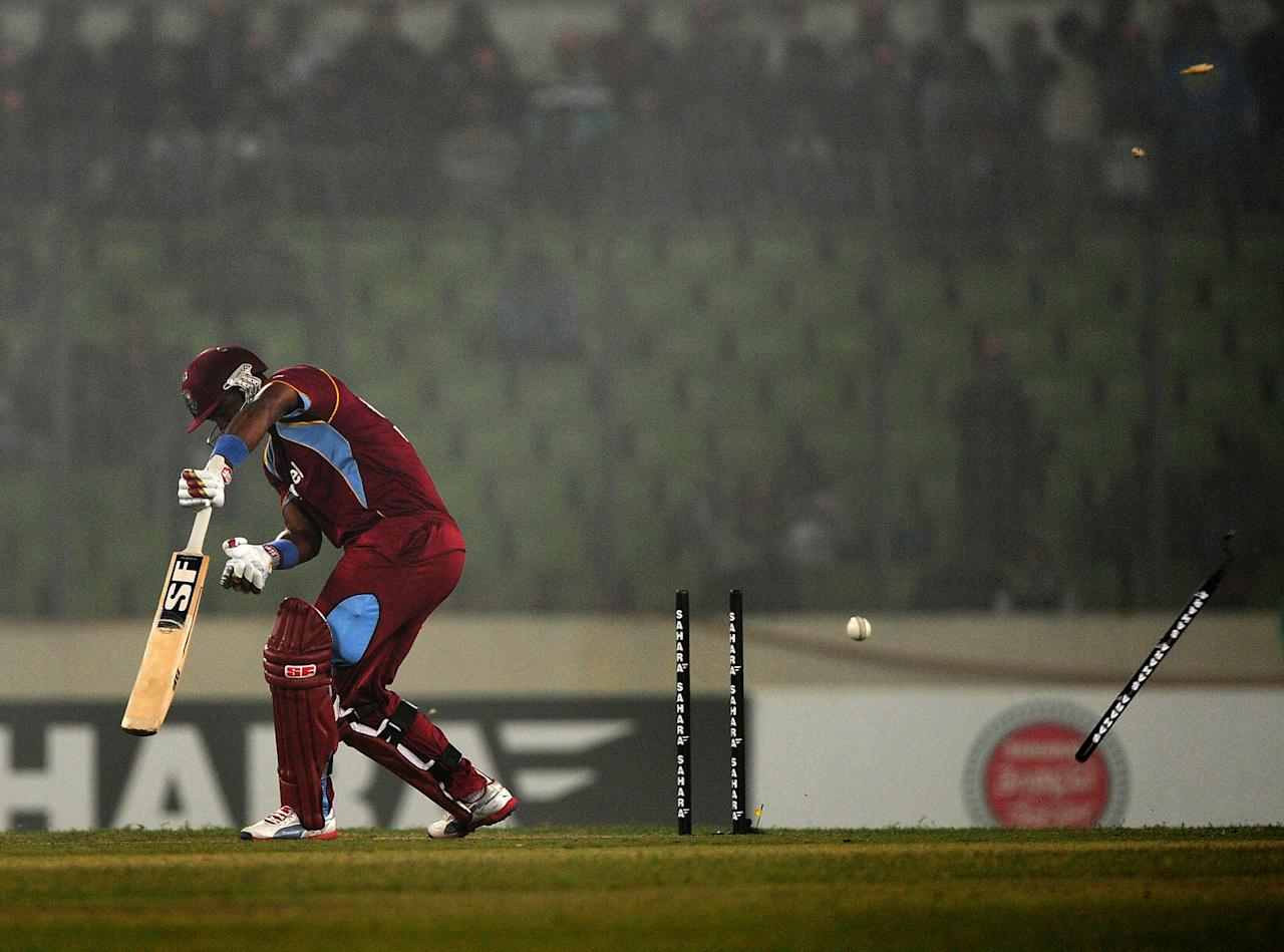 West Indies batsman Dwayne Smith is clean bowled by Bangladesh cricketer Rubel Hossain during the T20 match between Bangladesh and West Indies at the Sher-e-Bangla National Cricket Stadium in Dhaka on December 10, 2012. AFP PHOTO/ Munir uz ZAMAN