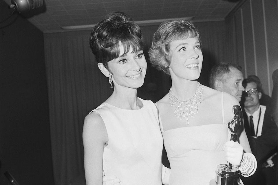 "<p>Audrey Hepburn posed with Best Actress winner Julie Andrews, who won for <em><a href=""https://www.goodhousekeeping.com/life/entertainment/news/a40147/mary-poppins-returns-julie-andrews-on-emily-blunt-casting/"" rel=""nofollow noopener"" target=""_blank"" data-ylk=""slk:Mary Poppins"" class=""link rapid-noclick-resp"">Mary Poppins</a></em>. Audrey's film <a href=""https://www.amazon.com/My-Fair-Lady-Julie-Andrewa/dp/B075DGBBLH/ref=sr_1_1?s=instant-video&ie=UTF8&qid=1547579181&sr=1-1&keywords=My+Fair+Lady&tag=syn-yahoo-20&ascsubtag=%5Bartid%7C10055.g.5132%5Bsrc%7Cyahoo-us"" rel=""nofollow noopener"" target=""_blank"" data-ylk=""slk:My Fair Lady"" class=""link rapid-noclick-resp""><em>My Fair Lady</em> </a>was also a big winner that night, taking home Best Picture, Best Director (George Cukor), and Best Actor (Rex Harrison).</p><p><span class=""redactor-invisible-space""><strong>RELATED: </strong><a href=""https://www.goodhousekeeping.com/life/g4938/best-musical-movies/"" rel=""nofollow noopener"" target=""_blank"" data-ylk=""slk:The 25 Best Musical Movies Ever Made"" class=""link rapid-noclick-resp"">The 25 Best Musical Movies Ever Made</a><br></span></p>"