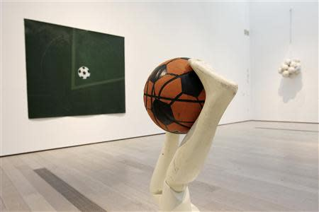 """""""Free Throw"""" by Mary Ellen Caroll is seen at the exhibition under construction, """"Futbol: The Beautiful Game"""", at the Los Angeles County Museum of Art (LACMA) in Los Angeles, California, January 27, 2014. REUTERS/David McNew"""