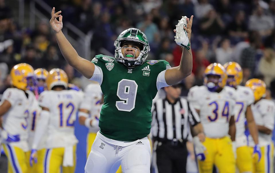 DETROIT, MI - DECEMBER 26: Mike Glass III #9 of the Eastern Michigan Eagles celebrates a touchdown during the first quarter of the game against Pittsburgh Panthers at the Quick Lane Bowl at Ford Field on December 26, 2019 in Detroit, Michigan. (Photo by Leon Halip/Getty Images)