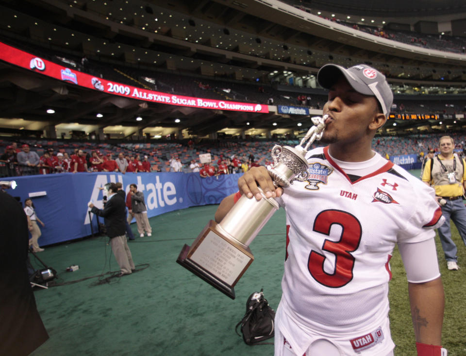 Utah quarterback Brian Johnson (3) kisses his Sugar Bowl MVP trophy after his NCAA football game in the Sugar Bowl in New Orleans, Saturday, Jan. 3, 2009.  Utah defeated Alabama 31-17. (AP Photo/Dave Martin)