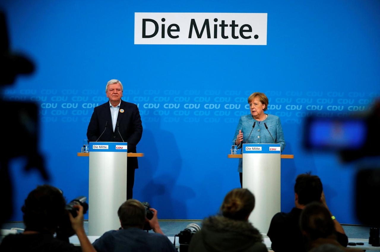 German Chancellor Angela Merkel and Hesse's State Prime Minister Volker Bouffier give a statement after leadership meeting at the CDU headquarters in Berlin, Germany, October 21, 2018. REUTERS/Hannibal Hanschke