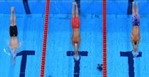 <p>An overview shows Germany's Florian Wellbrock (L), Ukraine's Mykhailo Romanchuk (C) and USA's Robert Finke as they dive to compete in the final of the men's 1500m freestyle swimming event during the Tokyo 2020 Olympic Games at the Tokyo Aquatics Centre in Tokyo on August 1, 2021. (Photo by François-Xavier MARIT / AFP)</p>