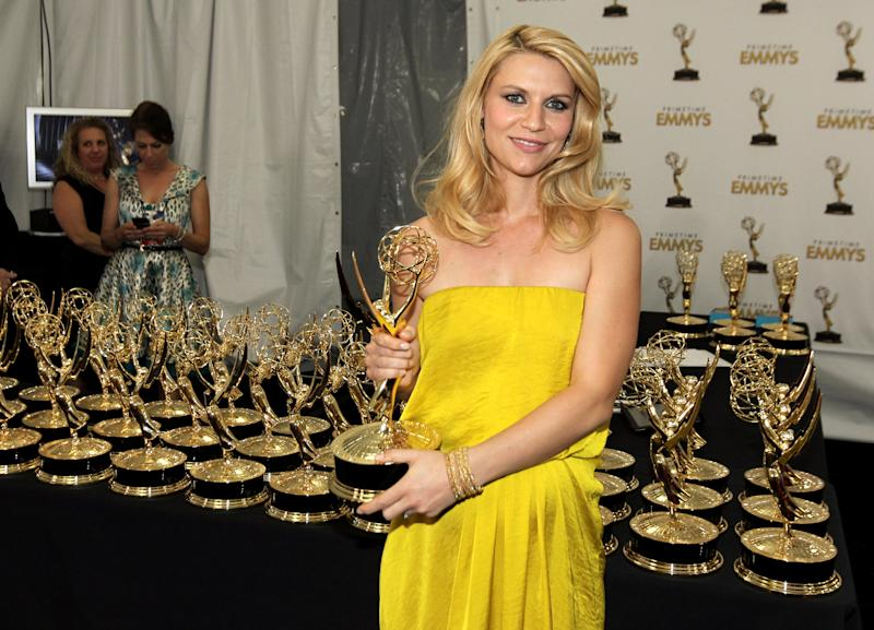 Actress Claire Danes, winner Outstanding Lead Actress In A Drama Series for 'Homeland', poses backstage at the 64th Primetime Emmy Awards at the Nokia Theatre on Sunday, Sept. 23, 2012, in Los Angeles. (Photo by Matt Sayles/Invision/AP)