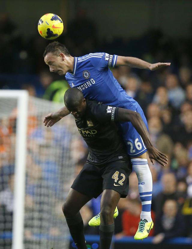 Chelsea's John Terry, above, vies for the ball with Manchester City's Yaya Toure during the English Premier League soccer match between Chelsea and Manchester City at Stamford Bridge Stadium in London, Sunday, Oct. 27, 2013. (AP Photo/Kirsty Wigglesworth)