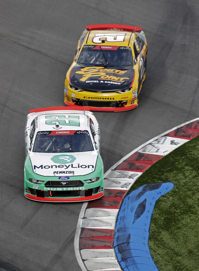 Austin Cindric (22) leads Daniel Hemric (21) through a chicane during the NASCAR Xfinity series auto race at Charlotte Motor Speedway in Concord, N.C., Saturday, Sept. 29, 2018. (AP Photo/Chuck Burton)