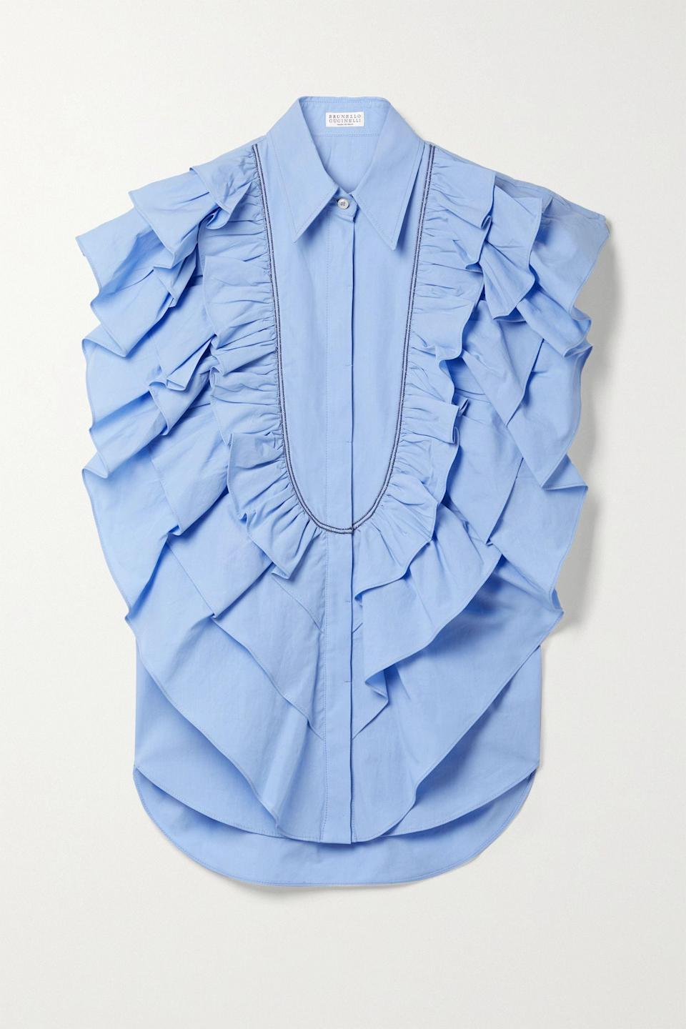 """<p><strong>Brunello Cucinelli</strong></p><p>net-a-porter.com</p><p><strong>$1695.00</strong></p><p><a href=""""https://go.redirectingat.com?id=74968X1596630&url=https%3A%2F%2Fwww.net-a-porter.com%2Fen-us%2Fshop%2Fproduct%2Fbrunello-cucinelli%2Fbead-embellished-ruffled-cotton-poplin-top%2F1319546&sref=https%3A%2F%2Fwww.townandcountrymag.com%2Fstyle%2Fg35967684%2Fwhat-to-wear-to-get-vaccinated%2F"""" rel=""""nofollow noopener"""" target=""""_blank"""" data-ylk=""""slk:Shop Now"""" class=""""link rapid-noclick-resp"""">Shop Now</a></p><p>Another statement top that can be easily paired with a classic pair of cigarette let pants, spiffy shoes, and deliver a look without oodles of effort.</p>"""