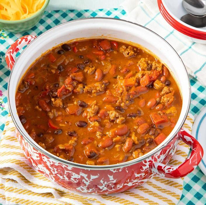"""<p>The touch of sweetness from pumpkin puree is just what this spicy chili needs. It's perfect for game day eats or easy fall dinners. </p><p><a href=""""https://www.thepioneerwoman.com/food-cooking/recipes/a36973563/pumpkin-chili-recipe/"""" rel=""""nofollow noopener"""" target=""""_blank"""" data-ylk=""""slk:Get the recipe."""" class=""""link rapid-noclick-resp""""><strong>Get the recipe. </strong></a></p><p><a class=""""link rapid-noclick-resp"""" href=""""https://go.redirectingat.com?id=74968X1596630&url=https%3A%2F%2Fwww.walmart.com%2Fsearch%3Fq%3Dpioneer%2Bwoman%2Bdutch%2Boven&sref=https%3A%2F%2Fwww.thepioneerwoman.com%2Ffood-cooking%2Fmeals-menus%2Fg36729946%2Fsavory-pumpkin-recipes%2F"""" rel=""""nofollow noopener"""" target=""""_blank"""" data-ylk=""""slk:SHOP DUTCH OVENS"""">SHOP DUTCH OVENS</a></p>"""